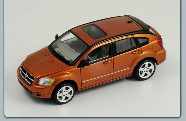 Spark: 2006 Dodge Caliber - Metallic Orange (S0862) im 1:43 maßstab